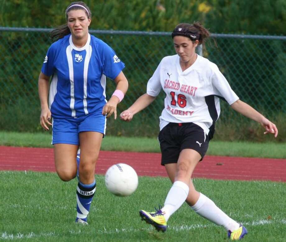 Photo by Russ McCreven Sacred Heart Academy's Alyssa Paolillo kicks the ball in the Pacers' 2-1 victory over West Haven.