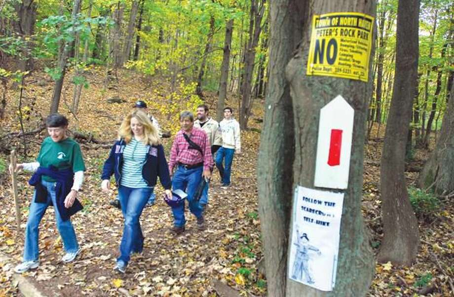 Photo by Arnold Gold Eilleen Fletcher (far left) of North Haven and Kristina Coppola (second from left) of Branford end a hike at the Peter's Rock Association Fall Festival in North Haven Sunday.