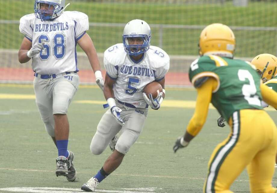 Photo by Russ McCreven West Haven's Andre Gee runs with the ball against Hamden.