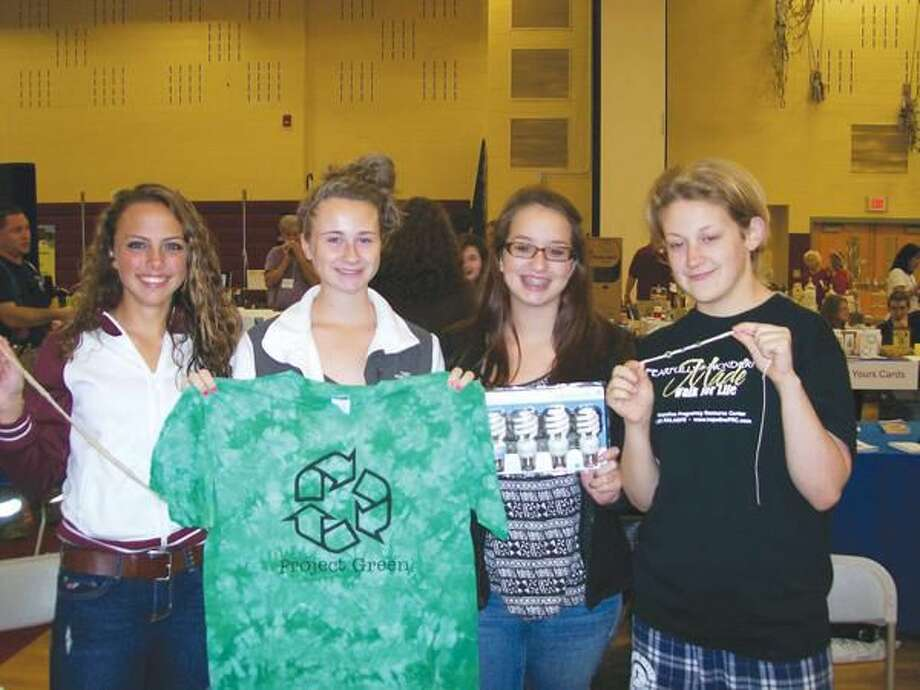 Photo by Lynn Fredricksen North Haven High School students representing Project Green manned their own booth at the recent Show & Sell. From left to right, Maggie Sullivan, Maggie Tebbetts, Raechel Bathrick and Alex Johnson.