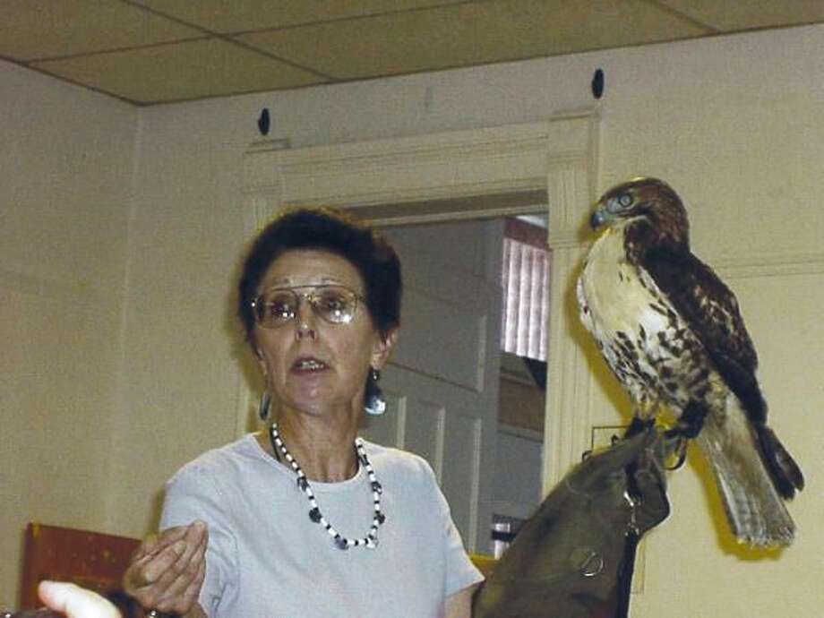 Submitted Photo Julie Anne Collier with Nipmunk, a Red-tailed hawk.