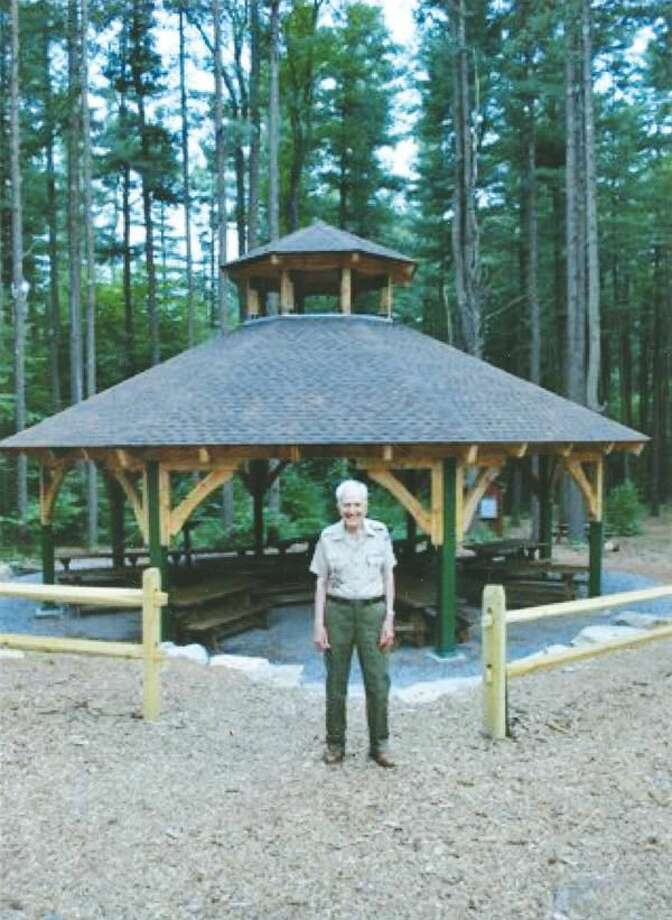 Submitted Photo Dr. Lawrence Pisani is shown in front of the pavilion named in his honor at the Connecticut Yankee Council's boy Scout Camp Sequassen in New Hartford.