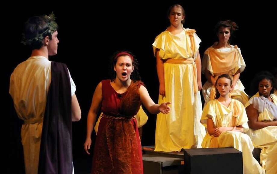 """In the North Haven High School production of """"Medea,"""" Grace Kenny plays Medea and Myles Morkowski plays Jason, with the Greek Chorus behind them. Mara Lavitt/Register 11/2/11"""