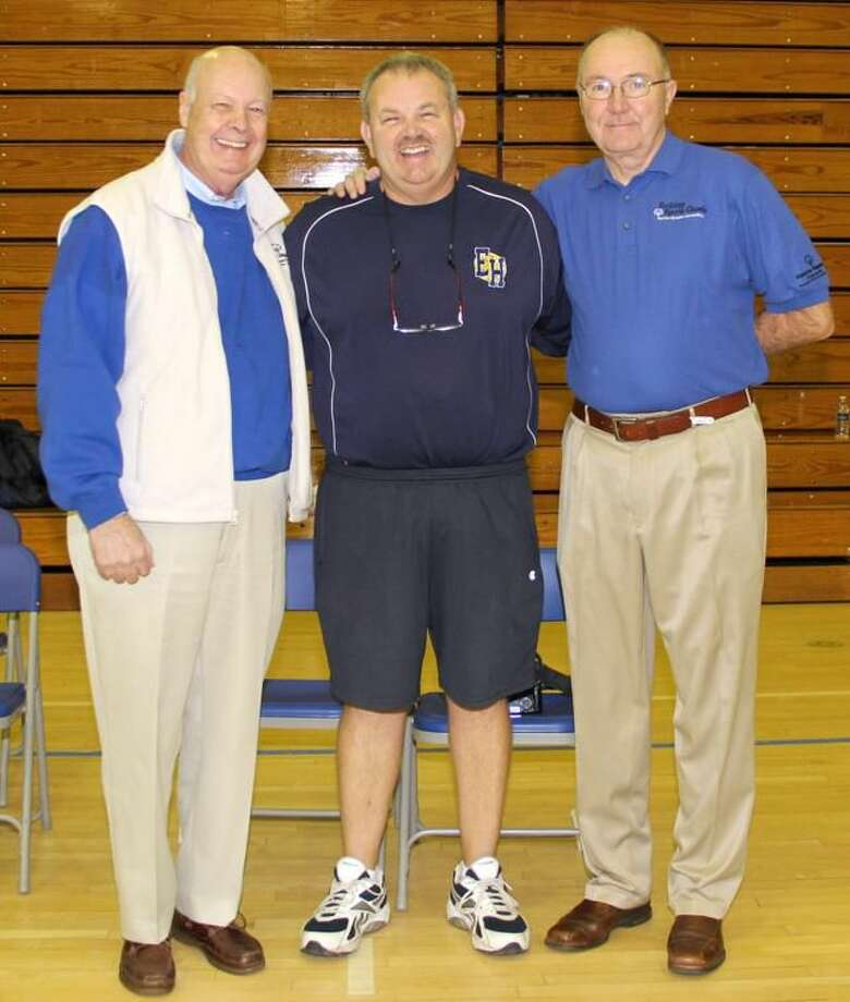 Submitted photo Pictured, from left to right, are Bill McNamara, representing IBM, Jim Reynolds, the director of the tournament, and Jack McDonald, the Athletic Director of Quinnipiac University.