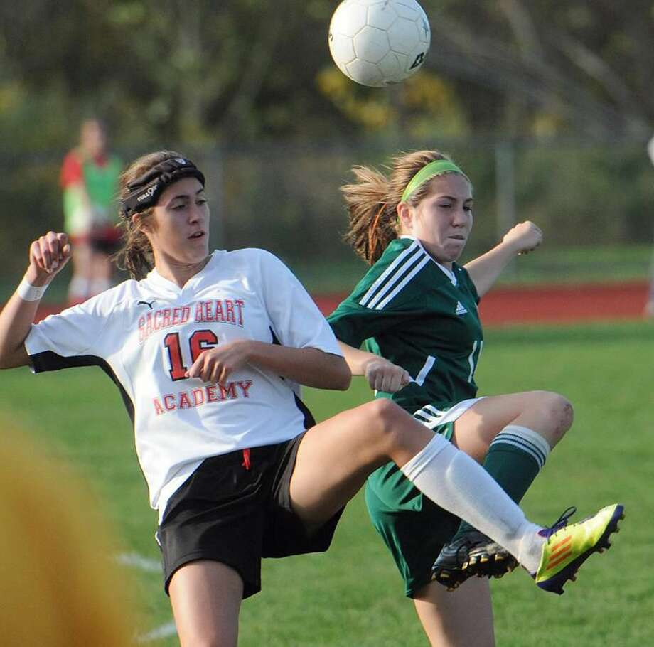 Photo by Peter Casolino/Register Sacred Heart's Alyssa Paolillo battles for a midfield ball with Hamden's Alice Matthews. Paolillo set a school record with 69 points (26 goals, 17 assists) this season.