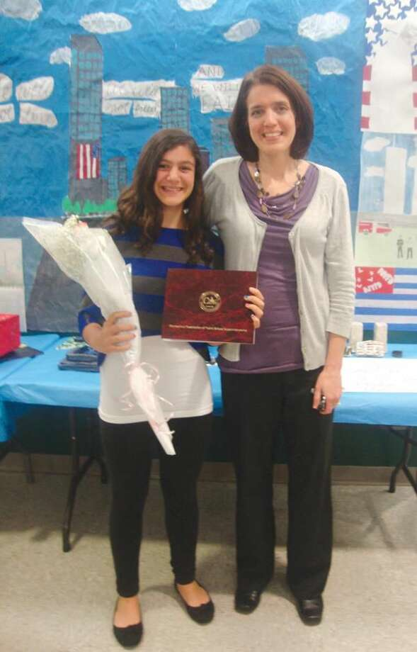 Submitted Photo Pictured is Alexa with her current sixth grade teacher, Sharon Weingart.