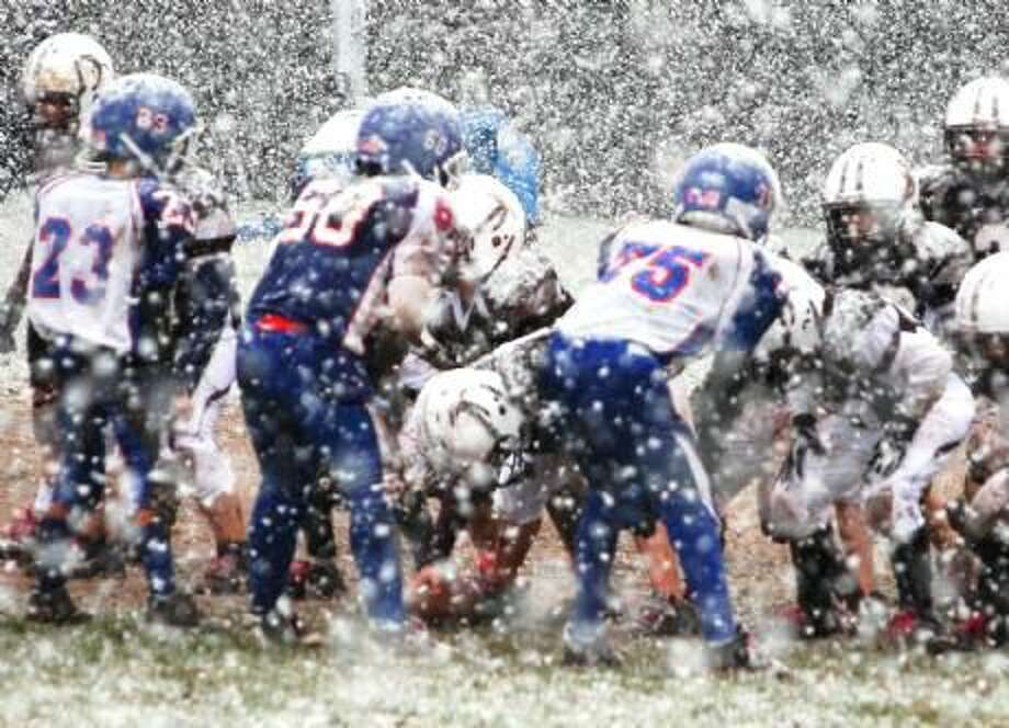 Photo courtesy of John Digregorio The North Haven fourth-grade B football team takes on Southington in the opening round of the playoffs in the snow.