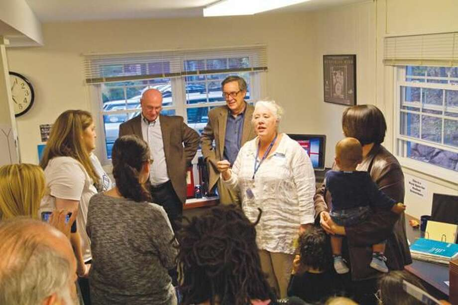 Submitted Photo Sharlene Walbaum, right, professor of psychology at Quinnipiac University, addresses those who attended an Oct. 21 open house for Quinnipiac's new Center for Psychological Research at 485 Sherman Ave. Walbaum is the director of the center.