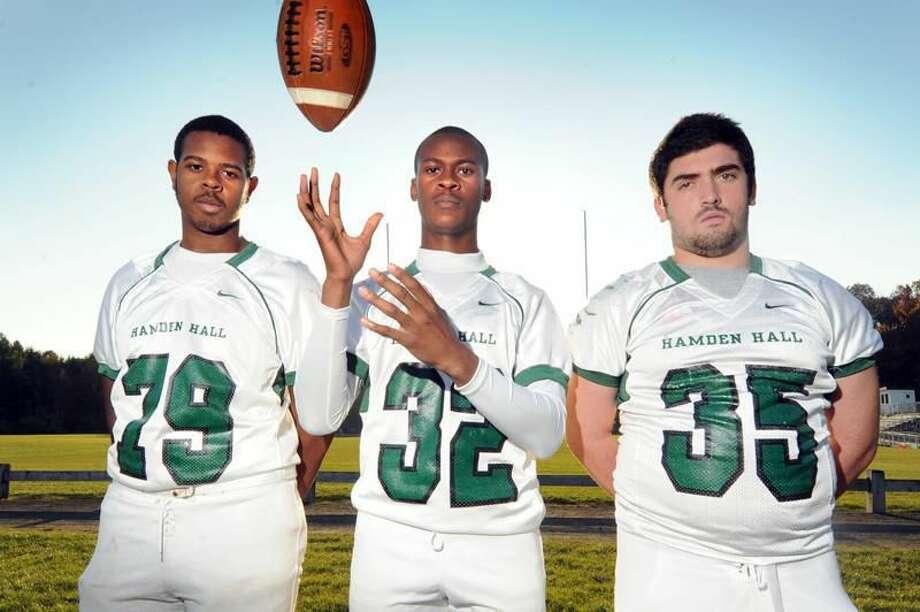 Tayler Thorpe, Curtis Antrum and Marc Cafasso. Hamden Hall High School football capts. vm Williams 11.08.11