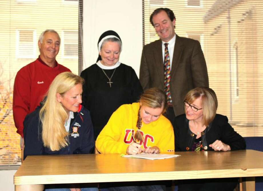 Submitted photo Sacred Heart Academy senior Deirdre Fitzpatrick signs her National Letter of Intent for the University of Southern California for rowing. Pictured, from left to right, are (back row): George Bedocs, SHA Athletic Director, Sr. Sheila O'Neill, ASCJ, Ph.D., President, Dr. Edward Fitzpatrick (Deirdre's father); (front row): Liz Tronde, coach of the Connecticut Boat Club, Deirdre Fitzpatrick and Maureen Fitzpatrick (Deidre's mother).