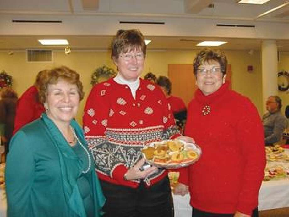 Submitted Photo Holiday Tea co-chairs Carmelina Villani, left, Carole Golitko, right, and State Representative Mushinsky, center.