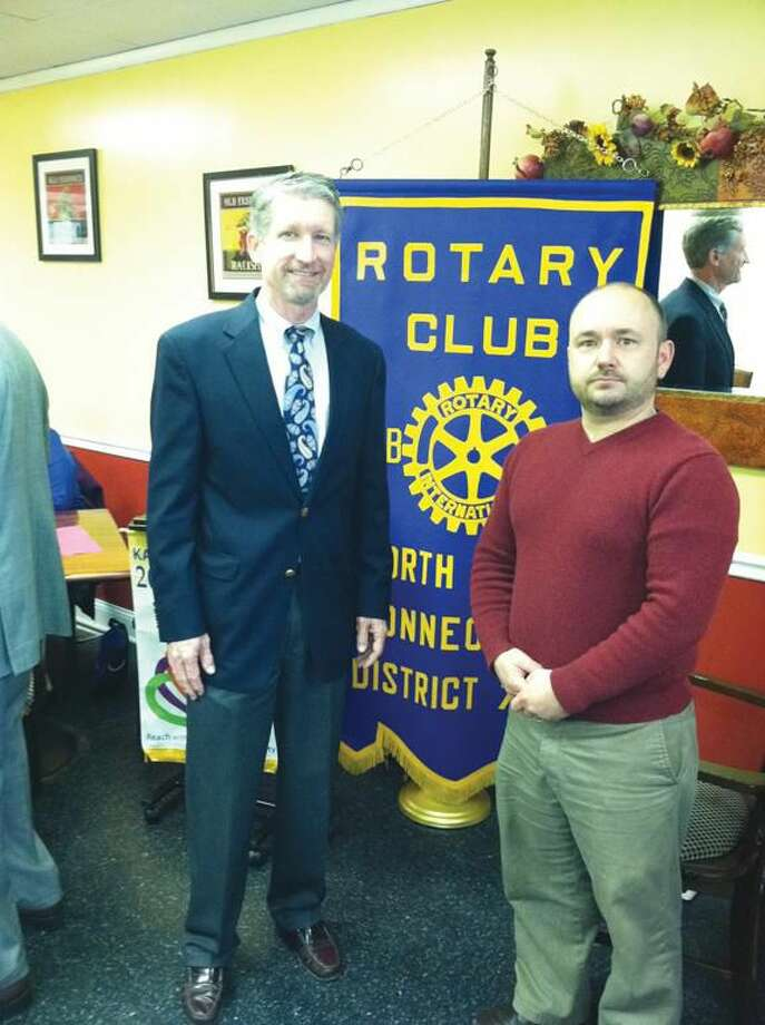 Submitted photo by David Marchesseault, Rotary PR Chairman Dr. Grant Thomson, left, founder of Hands Help Inc., extends his personal thanks to Rotarian Jonathan Martinek, right, for his ongoing support.