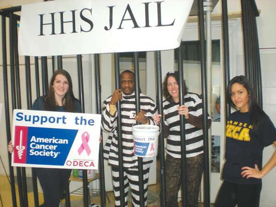 Submitted Photo Katie Reilly, Lock-Up Co-chairperson; Gary Highsmith, HHS Principal; Elizabeth Alexander, English teacher; and Diana Valdovinos, Lock-Up Co-Chairperson.