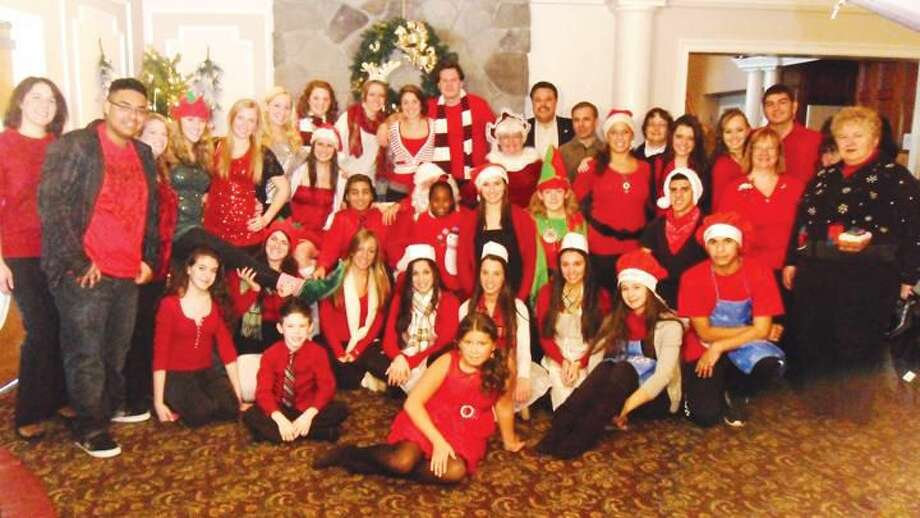 Submitted Photo Volunteers at the high school Interact Club's holiday extravaganza for children in need gathered for a group photo at the Fantasia Banquet Hall Dec. 3.
