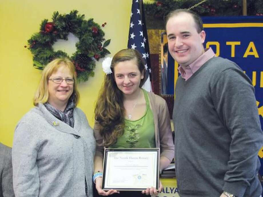 Submitted Photo Founders of the high school's Unsung Hero program, Rotarians Bernadette Casella and Brian Coughlin, congratulate award recipient Nicole Blair.
