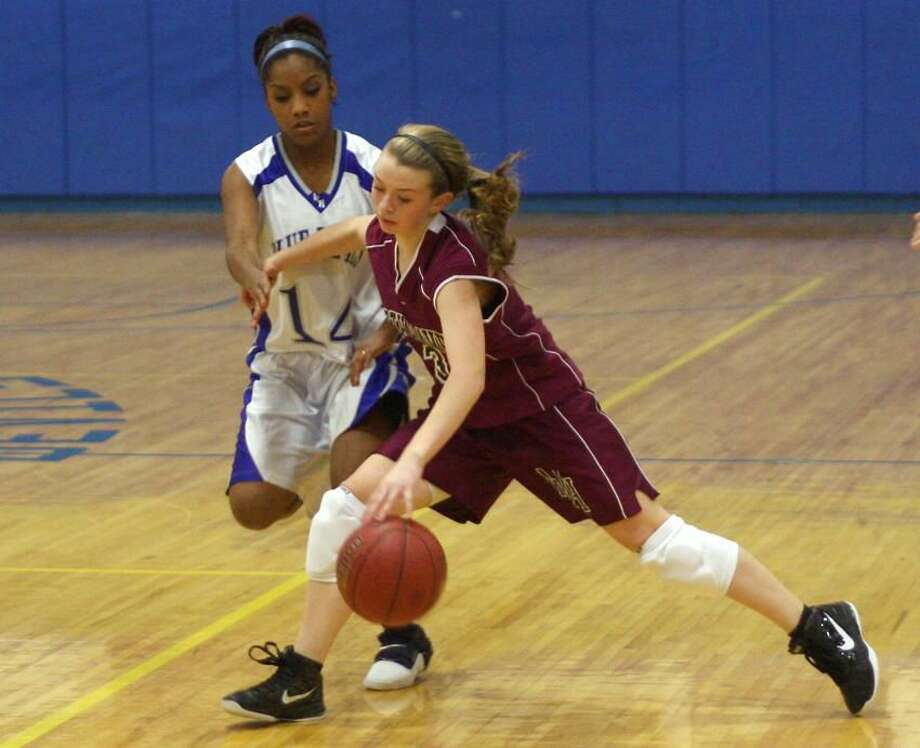 Photo Russ McCreven North Haven's Jill Johnson looks to make her way past West Haven's Talisha Martinez.