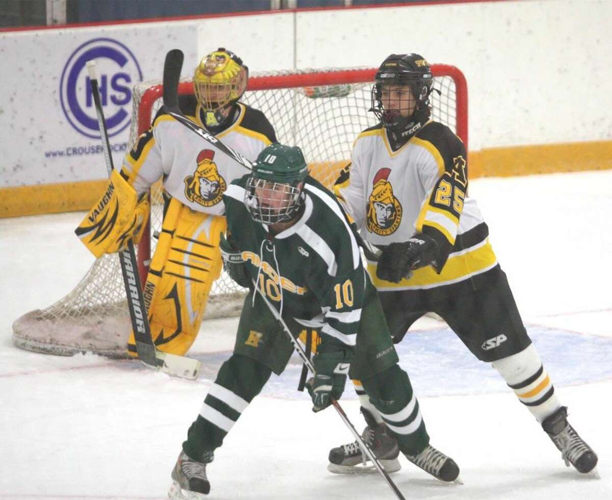 Photo by Russ McCreven Hamden's Connor Walsh (10) scored two goals and added an assist to lead the Green Dragons to a 7-2 victory over Amity on Friday afternoon.