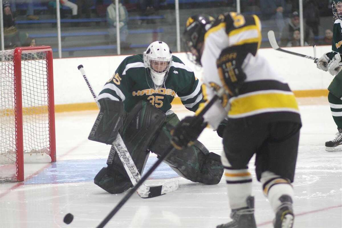 Photo by Russ McCreven Hamden goalie Andy Varga protects the net against Amity on Friday afternoon. Varga finished with 18 saves in the 7-2 victory.