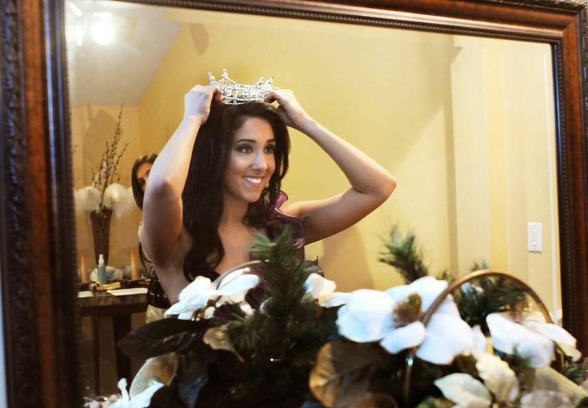 Miss Connecticut Morgan Amarone adjusts her crown in a mirror at Anthony's Ocean view in New Haven. (Melanie Stengel/Register)