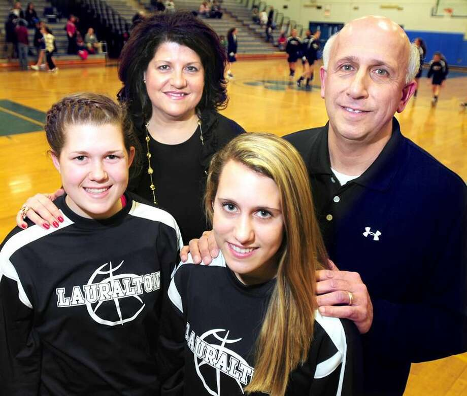 Carly Fabbri (front left) and Michelle DeSantis (front right) of Lauralton Hall are photographed with their parents Tricia Fabbri (back left) and Joe DeSantis (back right) before a recent game at Bunnell in Stratford. Photo by Arnold Gold/New Haven Register