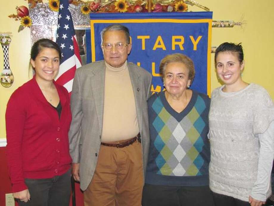 Submitted Photo by David Marchesseault, Rotary PR Chairman Rachel Hoffman, left, and Kayla Garriott, right, recently received the North Haven Rotary Foundation's QU scholarship funds donated through Farooq & Eileen Khan, center, representing the Montowese Health & Rehabilitation Center.