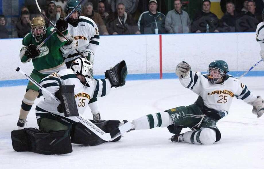 Hamden— Hamden's Vito Puopolo and goalie Andy Varga deflect a slap shot by Notre Dame during the first period. Peter Casolino/New Haven Register