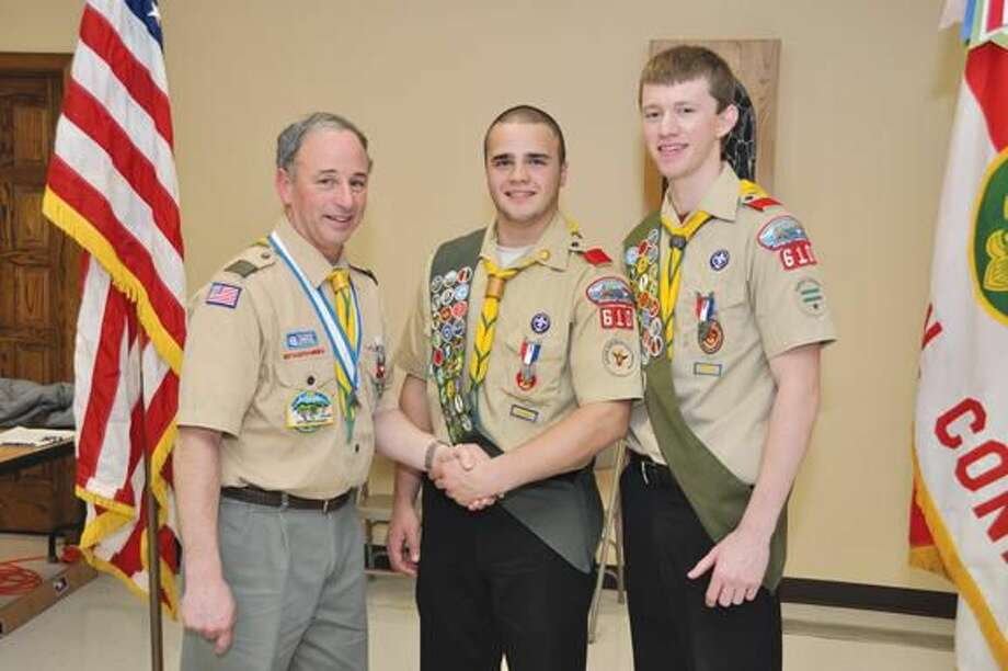 Submitted photo Scoutmaster Bill Earley congratulates Troop 610 Eagle Scouts Matt Altieri and Matt McPhail.