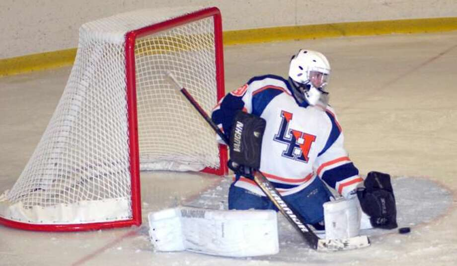 Photo by Dave Phillips Lyman Hall goalie Steve Esposito makes a stop against Branford.