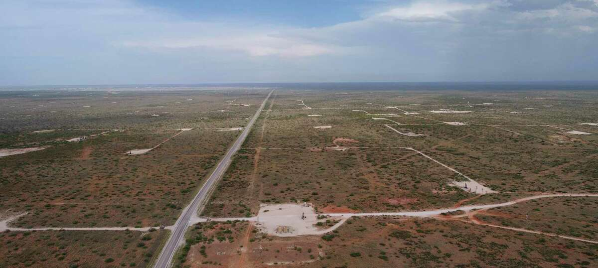 Drilling sites mark the landscape near Eunice, N.M. The U.S. shale industry is shrinking to survive amid an environment of depressed crude prices and Wall Street animosity toward nearly all things oil and gas.