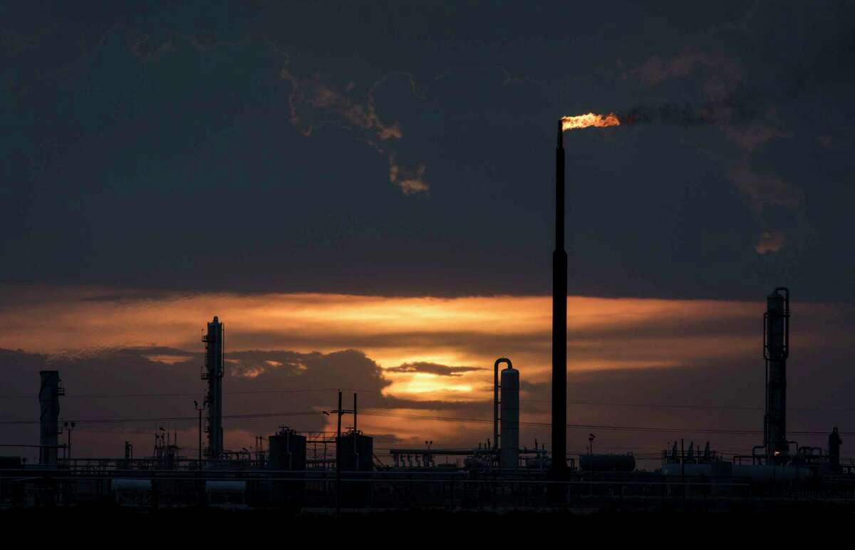 The sun sets behind a Lucid Energy gas processing plant on Thursday, Aug. 22, 2019, near Jal, N.M. One major source of emissions in West Texas is venting or flaring of gas from oil and gas facilities. Average daily flaring rates in the Permian Basin climbed past 700 million cubic feet per day in 2019, a nearly 21-fold increase from seven years earlier and more than enough gas needed to power every home in Texas.