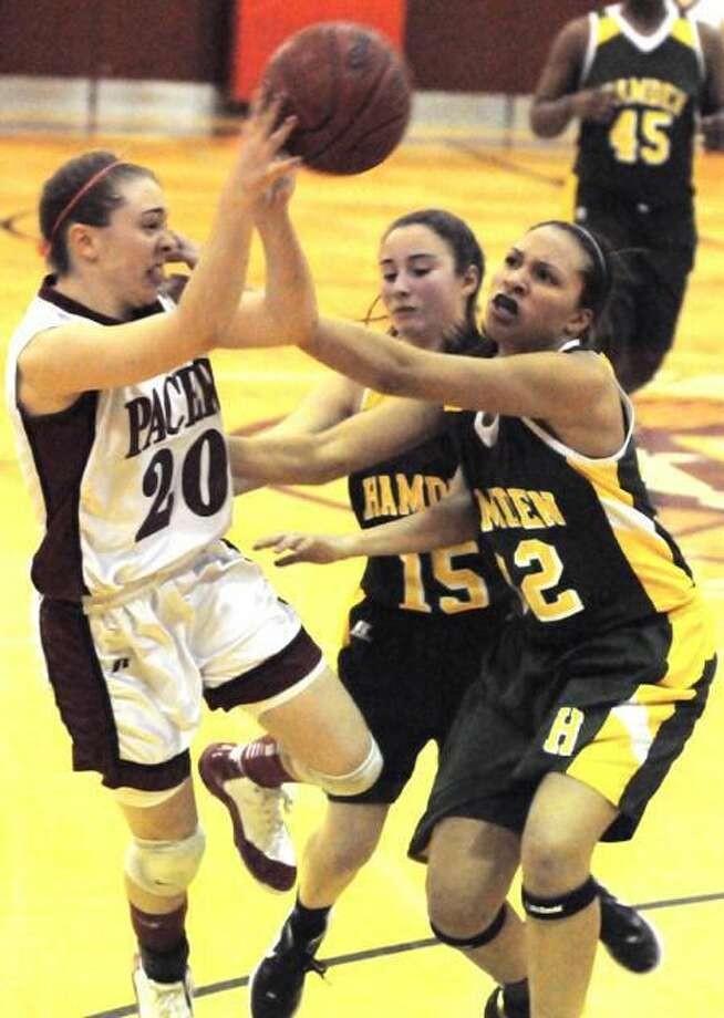 Natalie Bastian of Sacred Heart Academy, left, gets fouled by Hamden's Zoe Fanolis, center, and Morgan Rams during the waning seconds of Sacred Heart Academy's 59-57 win over Hamden. Photo by Peter Hvizdak / New Haven Register