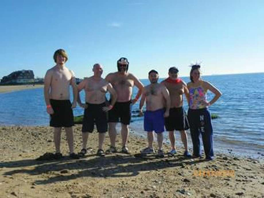 Submitted photo by Jennifer Bassett Taking the plunge to fight breast cancer on New Year's Day were (left to right) Adam and Rick Bassett, Guy Casella, Jon Martinek, Leo Cegelka and Katie Moss.