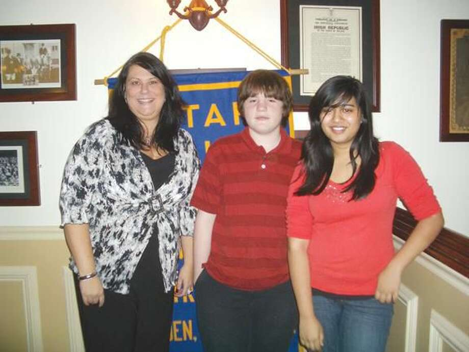 Submitted Photo Hamden High School students Peter Collier and Anika Matin are pictured with Joena Russell, President-Elect of Hamden Rotary Club.