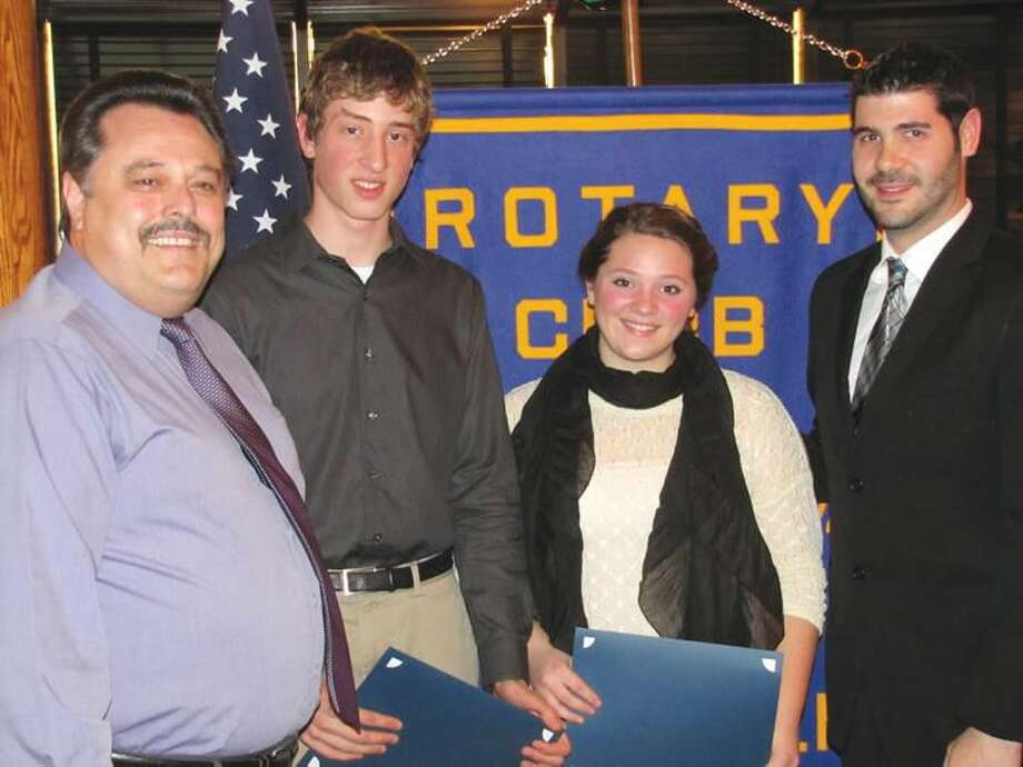 Submitted Photo by David P. Marchesseault North Haven Rotary Club President Guy Casella (left) and Admin. Intern Chris McLaughlin (right) congratulate North Haven High School Students of the Month Doron Rose and Kayla DeLuca.
