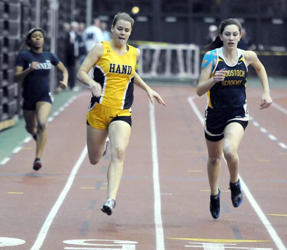 Photo by Mara Lavitt/Register Joya Helander of Hand crosses the line of the 300m race.