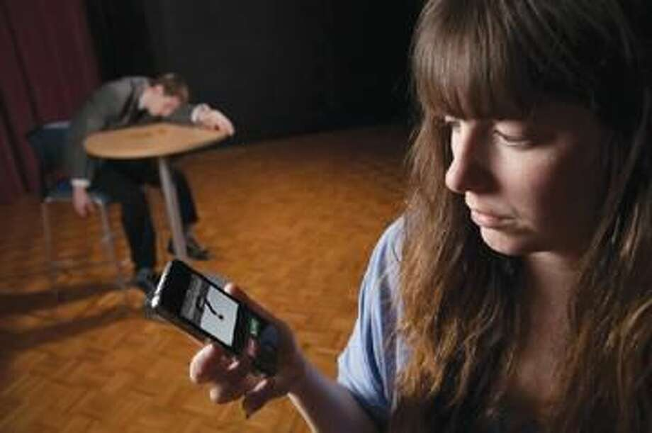 """Submitted Photo Kasey Quinlan, right, and Kevin Mahoney rehearse a scene from """"Dead Man's Cell Phone."""""""