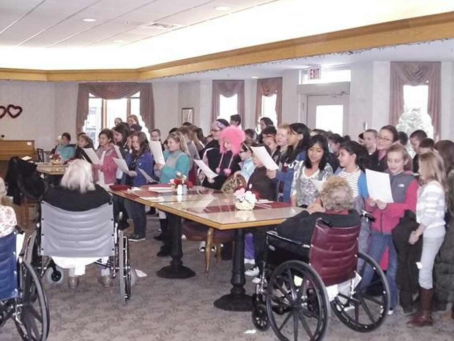 Submitted Photo Montowese Leadership Council members sing to residents at Hamden Health Care Cente.
