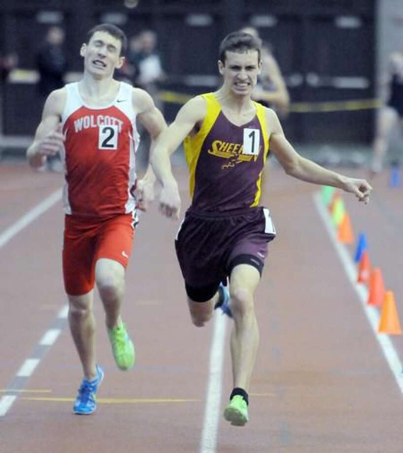 Class M Track championship: Sheehan's Thomas Lupoli wins the 1000m over Joseph Gioielli of Wolcott. Photo by Mara Lavitt/New Haven Register