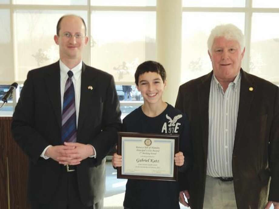 Pictured along with HMS Principal Dan Levy and current Hamden Rotary President John Nolan is Principal's List award winner Gabriel Katz.