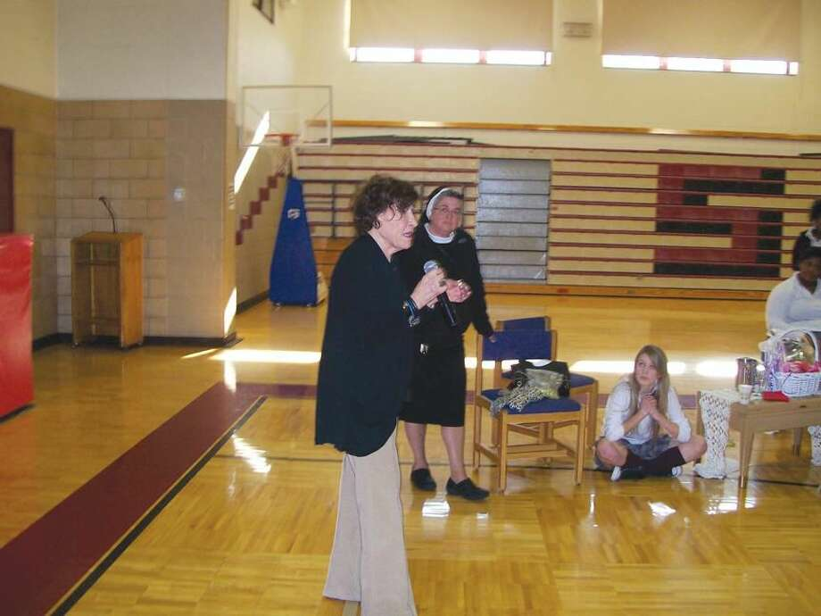 Photo by Lynn Fredricksen Holocaust surviver Anita Schorr, of Westport, addresses Sacred Heart Academy students at a recent Diversity Day held at the school.