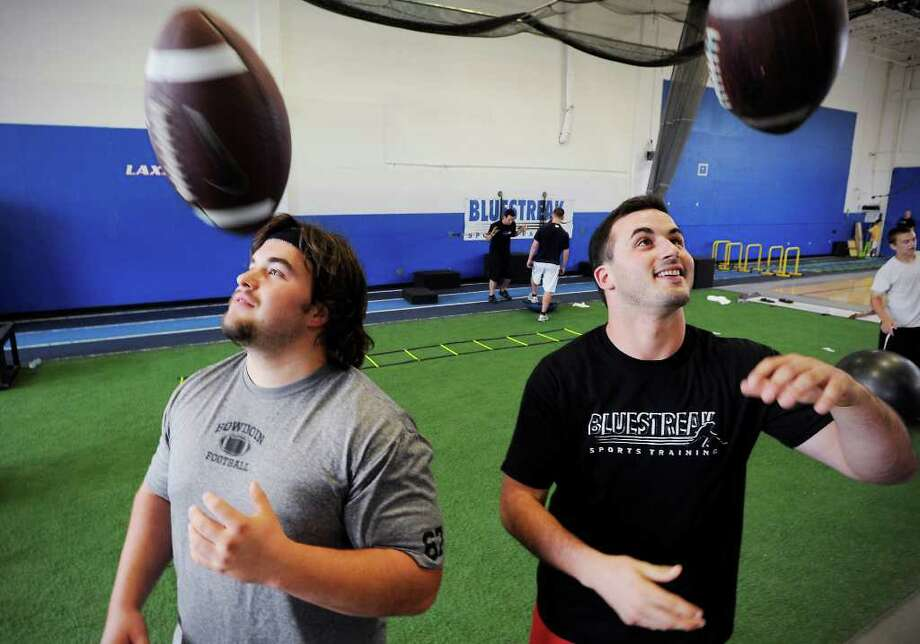 Kyle Duncan and Vinny Cortese at Blue Streak Sports in Stamford, Conn. on Friday August 6, 2010. The two will each be playing football with their younger brother on the same college football team next year. Photo: Kathleen O'Rourke / Stamford Advocate