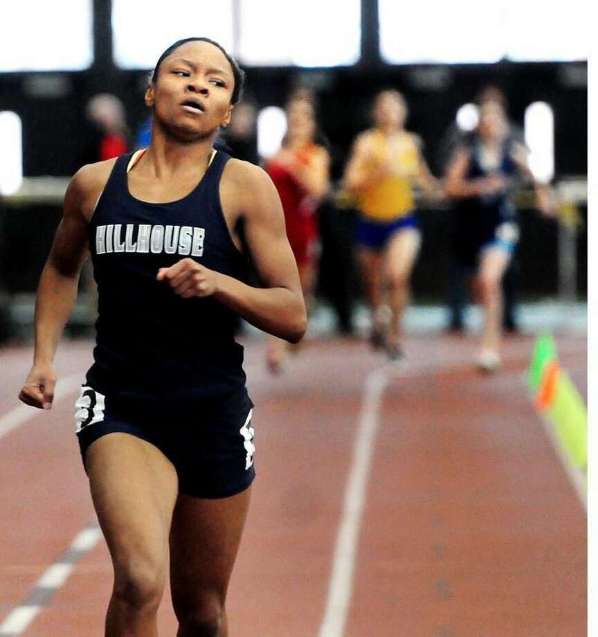 State Open Track Championships-Precious Holmes approaches the finish line in the 300 meters as the rest of the pack rounds the final turn Holmes set a new state record. Melanie Stengel/Register