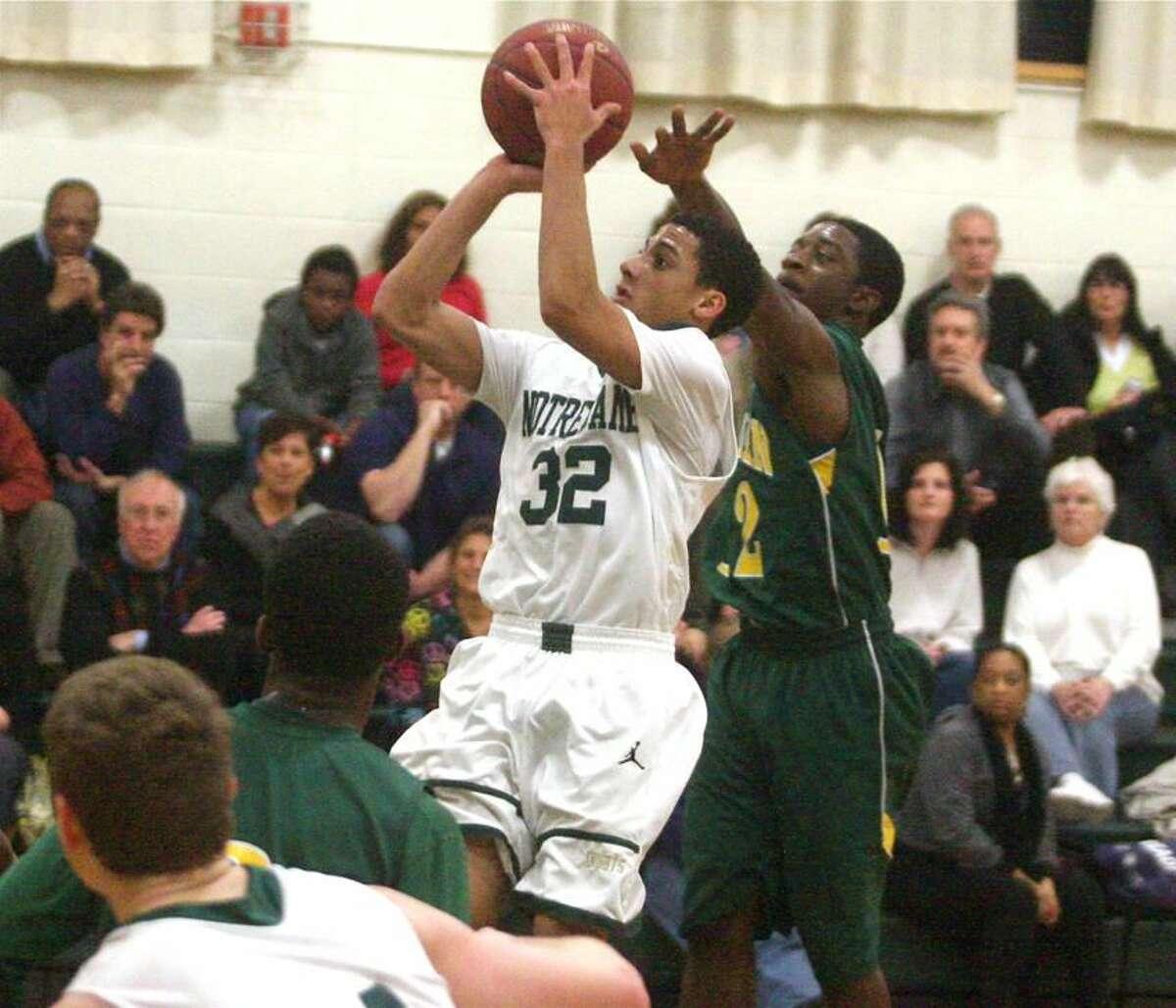Photo by Russ McCreven Notre Dame's Lonnie Blackwell fires a jump shot against Hamden.