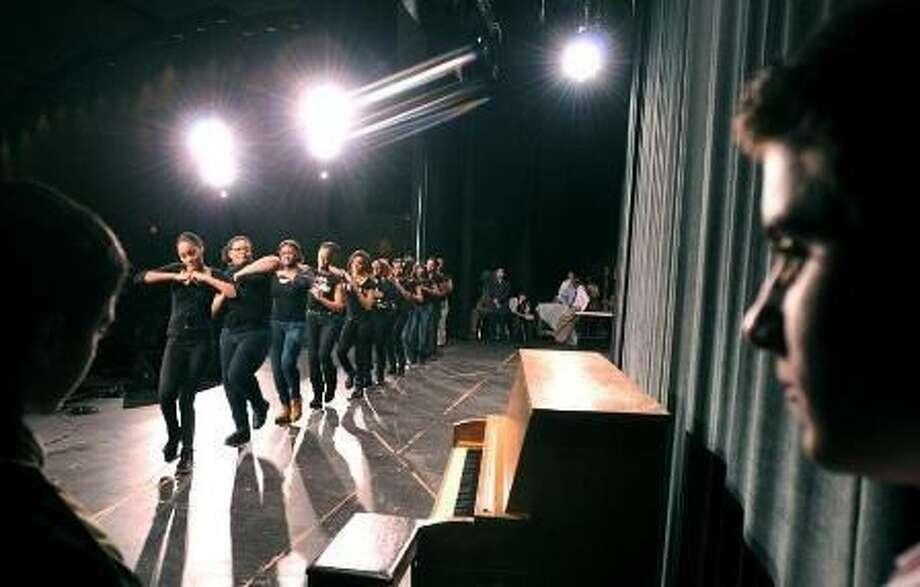 The Hamden Middle School steppers dance troupe performs during the Hamden Middle School Black History Month Assembly Thursday. Peter Hvizdak/Register