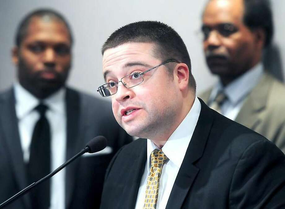 Attorney Isaias Diaz, chairman of the Latino and Puerto Rican Affairs Commission, speaks at a press conference at the Legislative Office Building in Hartford Monday seeking an overhaul of the Alvin W. Penn Racial Profiling Prohibition Act. Arnold Gold/Register