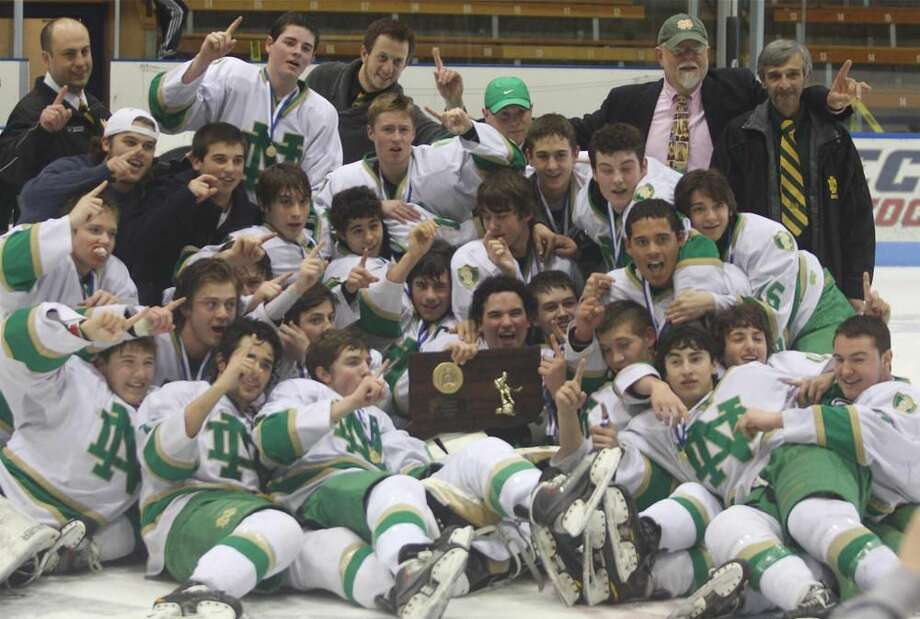 Photo by Russ McCreven The Notre Dame-West Haven hockey team celebrates the Division I hockey championship. The Green Knights finished No. 1 in the final New Haven Register Top 10 poll.