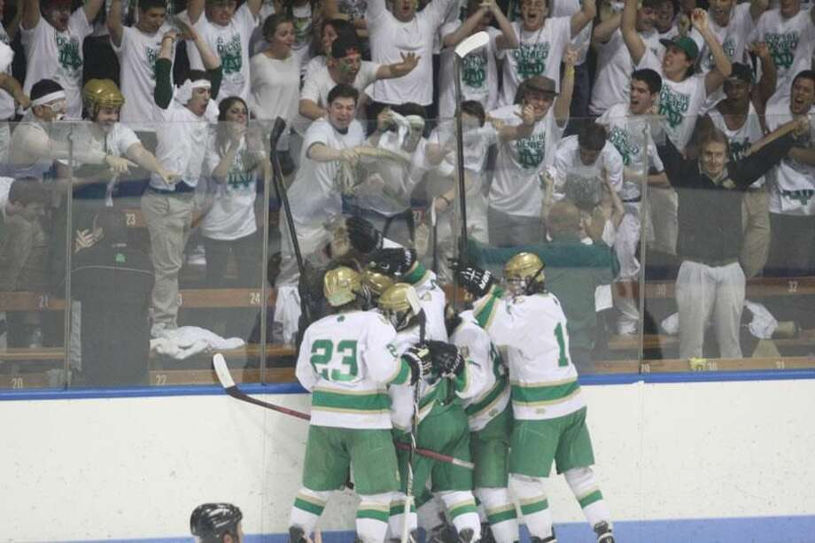 Photo by Russ McCreven Notre Dame-West Haven hockey players celebrate with the fans after Alex Esposito scored a goal in Saturday's championship win over Glastonbury in the CIAC Division I hockey final at Ingalls Rink.