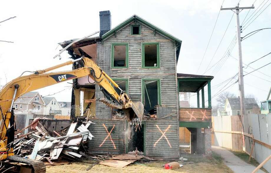 A house at 59 Edwards St. in Hamden is demolished on 3/23/2012 as part of a Hamden Economic Development Corporation remediation project.Photo by Arnold Gold/New Haven Register AG0444D