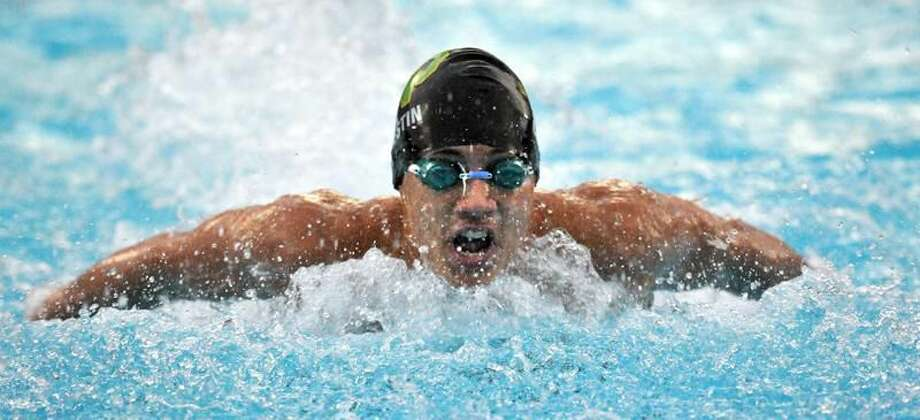 Notre Dame-West Haven's Nicholas Celestin on his way to a first place in the 100-Yard Butterfly. Peter Casolino/New Haven Register