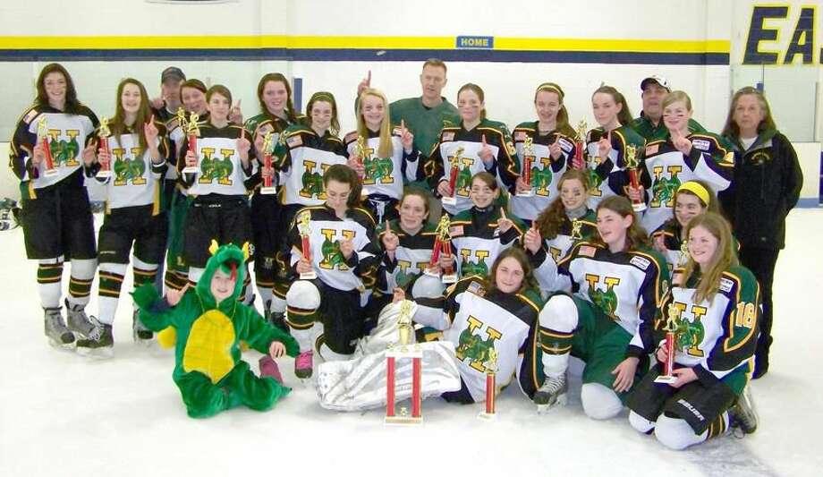 Submitted photo The Hamden girls' U14 hockey team celebrates its Connecticut Girls' Hockey League Division I championhip.